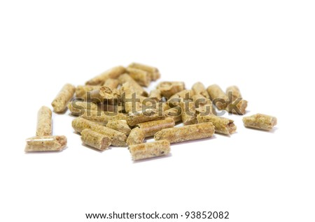 macro of wood pellets isolated on white - stock photo