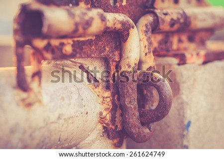 Macro old and rusty metal latch, retro filter effect - stock photo