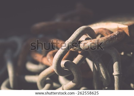 Macro old lock and rusty chain on black background - stock photo
