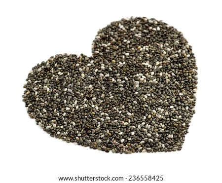 Macro perspective of natural chia seeds in heart shape - stock photo