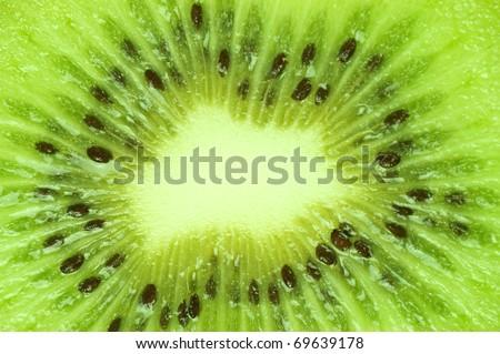 Macro photo of a fresh kiwi - stock photo