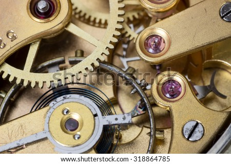 Macro photo of a pocket watch movement , cogwheels and clockwork - stock photo