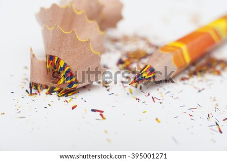 Macro photo of a thick multi-colored wooden classic pencil sharpened. Focus on the areas of multi-colored bright ground off the lead in a pencil rolled rings. - stock photo