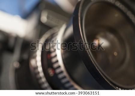 Macro photo of a vintage lens medium format film camera. Focus on the rim of the lens. - stock photo