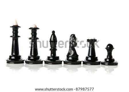 macro photo of all black chess piece isolated on a white background - stock photo