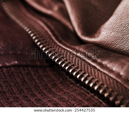 Macro photo of an elegant brown leather jacket.