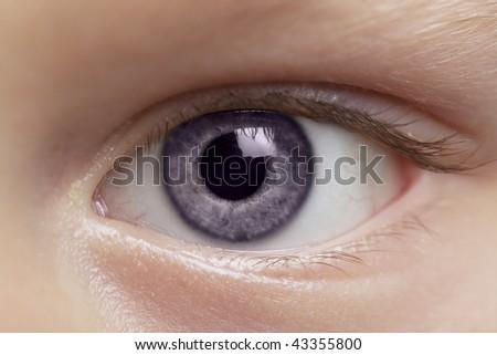 Macro photo of beautiful young boy's eye - stock photo