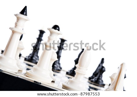 macro photo of chess pieces isolated on a white background - stock photo