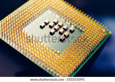 Macro photo of Computer microprocessor on blue background. - stock photo