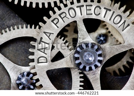 Macro photo of tooth wheel mechanism with DATA PROTECTION concept letters - stock photo