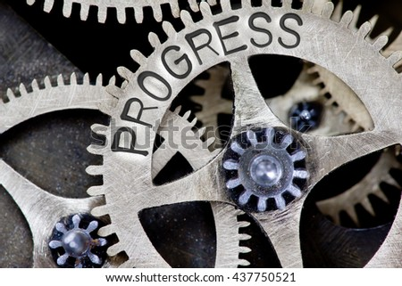 Macro photo of tooth wheel mechanism with PROGRESS concept letters - stock photo