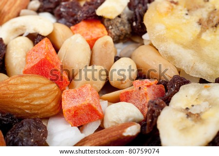 Macro photo of trail mix with peanuts, almonds, raisins, bananas and other natural foods - stock photo