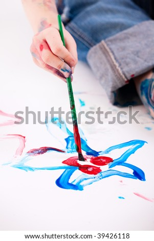 Macro photo of  5 years old boy painting on white background - stock photo