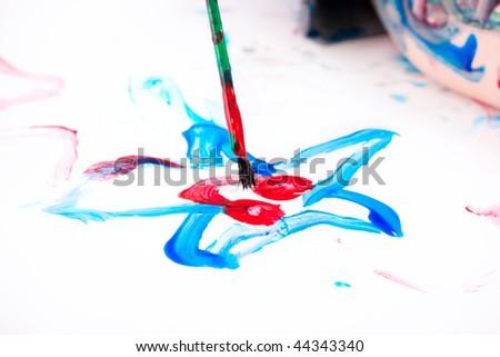 Macro photo of 5 years old boy painting on white background - stock photo