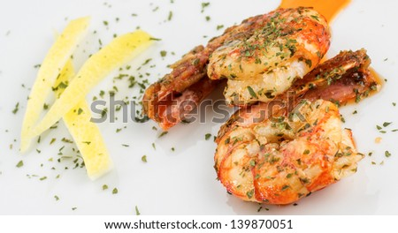 macro photograph of a prawn dish decorated with lemon - stock photo