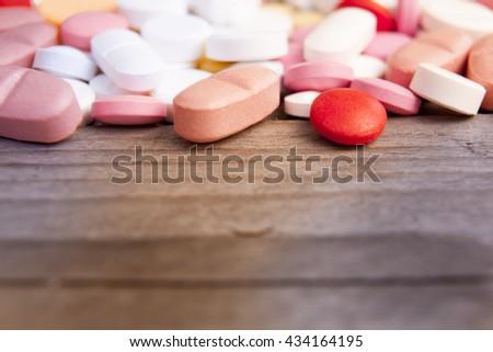Macro photograph of various colorful medicinal pills - stock photo