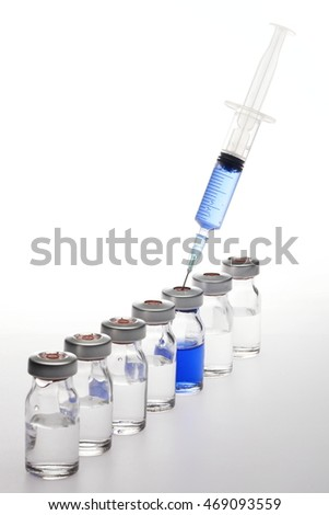 Macro photographed in studio environment vaccines and syringes