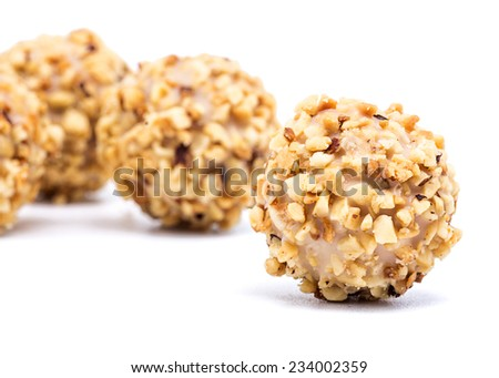 macro photography chocolates with almonds on white background - stock photo