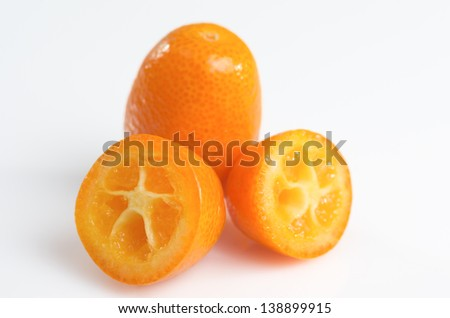 Macro photography kumquats over white background