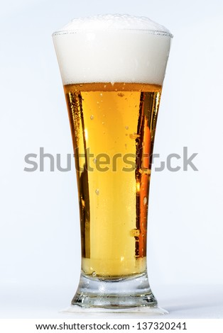 macro photography of beer on white background