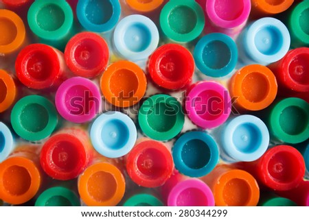 Macro photography of bunch of markers in different colors like red, blue, green, pink and orange from top view