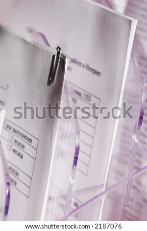 macro picture of commercialese document in paper tray