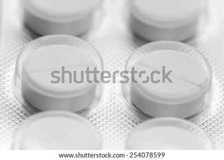 Macro picture of two tablets in the plate - stock photo