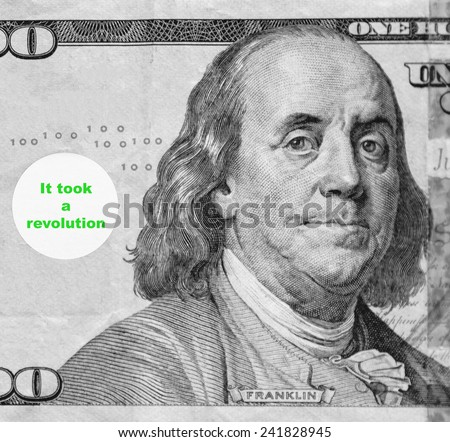 "Macro portrait of Benjamin Franklin from hundred-dollar U.S. bill with word balloon: ""It took a revolution"" (in black and white, except for green text; some identifiers have been removed) - stock photo"