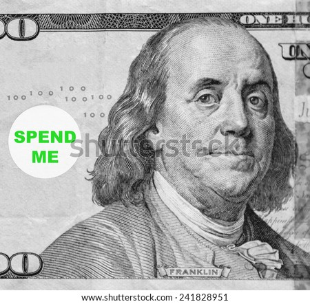 "Macro portrait of Benjamin Franklin from hundred-dollar U.S. bill with word balloon: ""Spend me"" (in black and white, except for green text; some identifiers have been removed) - stock photo"