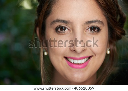 macro portrait of young latino  girl in park