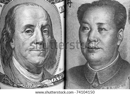 Macro portraits of Benjamin Franklin and Mao Tse-Tung in the US and China currencies respectively - stock photo