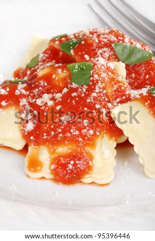 Macro ravioli with Parmesan cheese - stock photo
