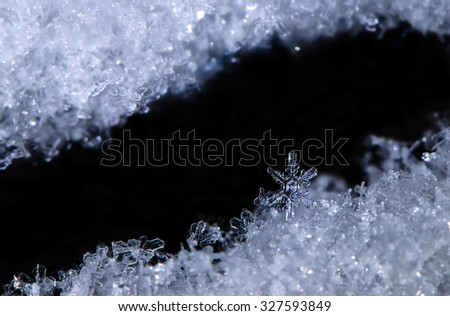 Macro Real Snowflake Close Up on Snowdrift in Winter Weather - stock photo