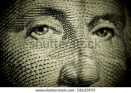 Macro shallow depth of field shot of dollar bill GEORGE WASHINGTON FACE - stock photo