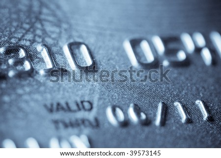 Macro shoot of a credit card. Digits in focus. Can be used as a background - stock photo