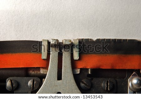 macro shoot of typewriter with blank page for copy text