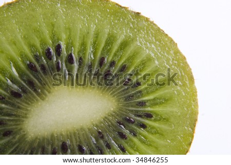 Macro shot. Close up kiwi isolated on white background
