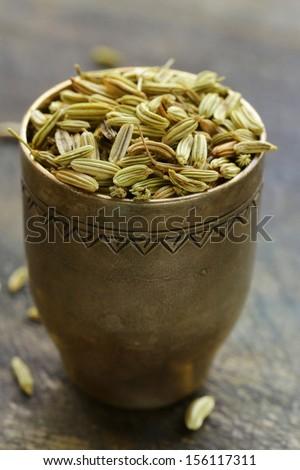 macro shot fennel seeds, aromatic spice seasoning - stock photo