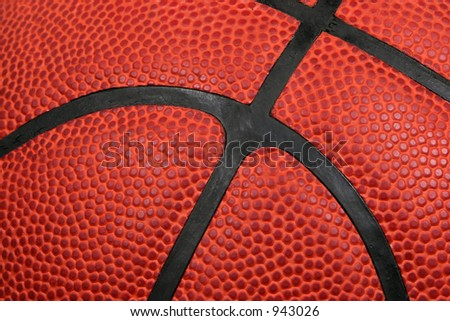 Macro shot of a basketball showing the individual dimples on the ball and the black rubber stripes. - stock photo