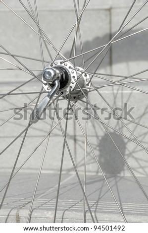 Macro shot of a bicycle wheel. Focus on hub. - stock photo