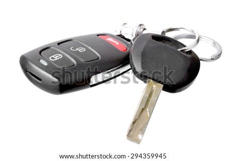 Macro shot of a car remote and a key on a white background