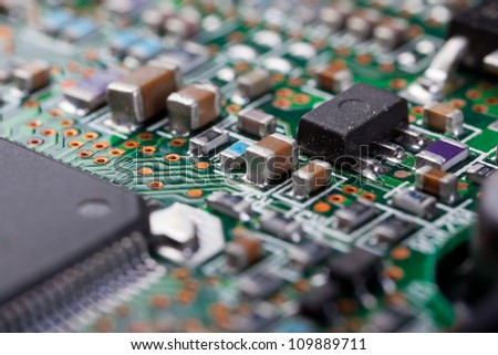 Macro shot of a dirty circuit board - stock photo