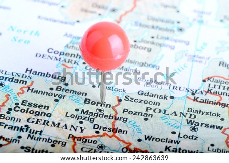 Macro shot of a European map showing Berlin in Germany - stock photo