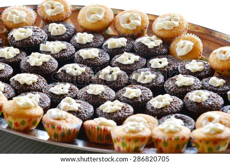Macro shot of a group of  chocolate and vanilla mini cupcakes - stock photo