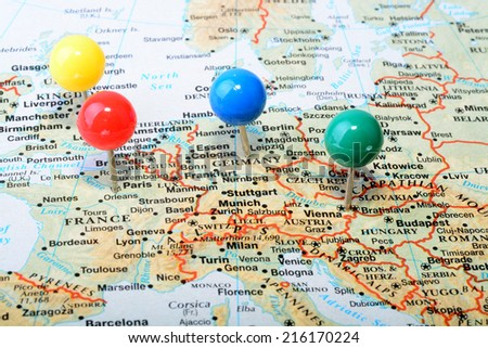 macro shot of a map showing main western europe cities with a colorful tack