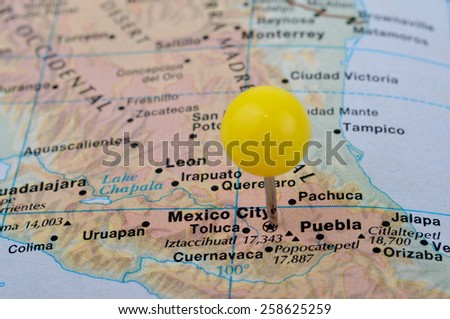 Macro shot of a map showing Mexico City - stock photo