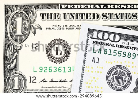 Macro shot of a new 100 dollar bill and one dollar on background