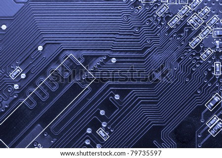 Macro shot of a printed circuit board with details of connection and chip