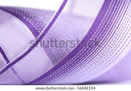 Macro shot of a purple ribbon - stock photo