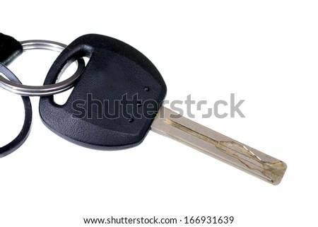 Macro shot of a regular car key isolated on white - stock photo